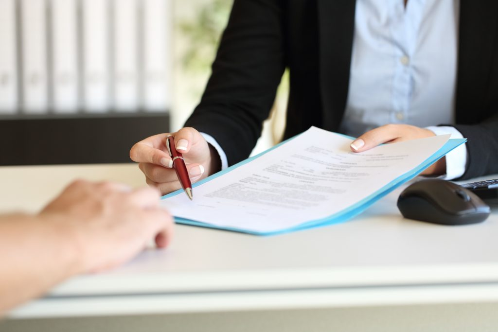Signing car hire insurance document