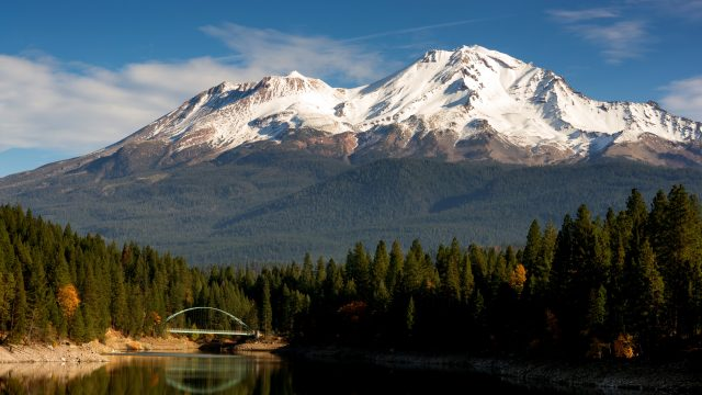 Mount Shasta rising above Shasta Lake in the Sierra National Forest